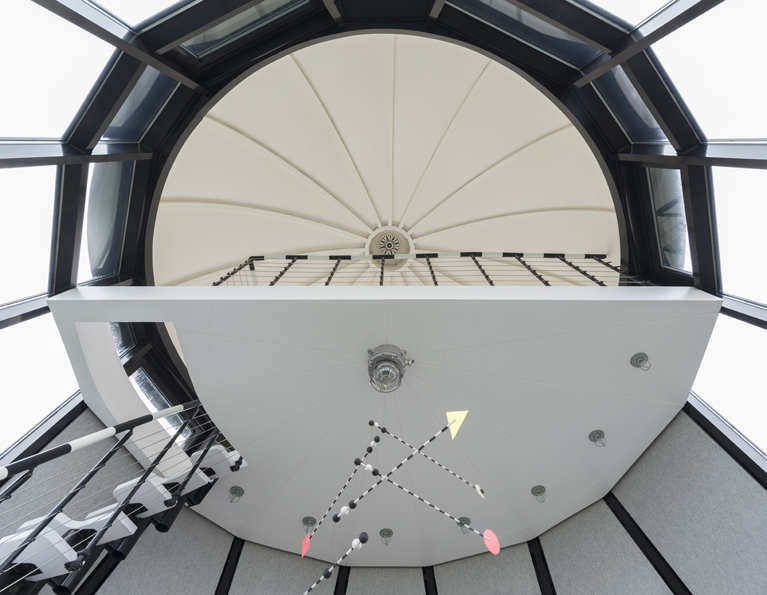 A sleeping platform under the segmented dome affords panoramic views of the sea and the Norfolk landscape.