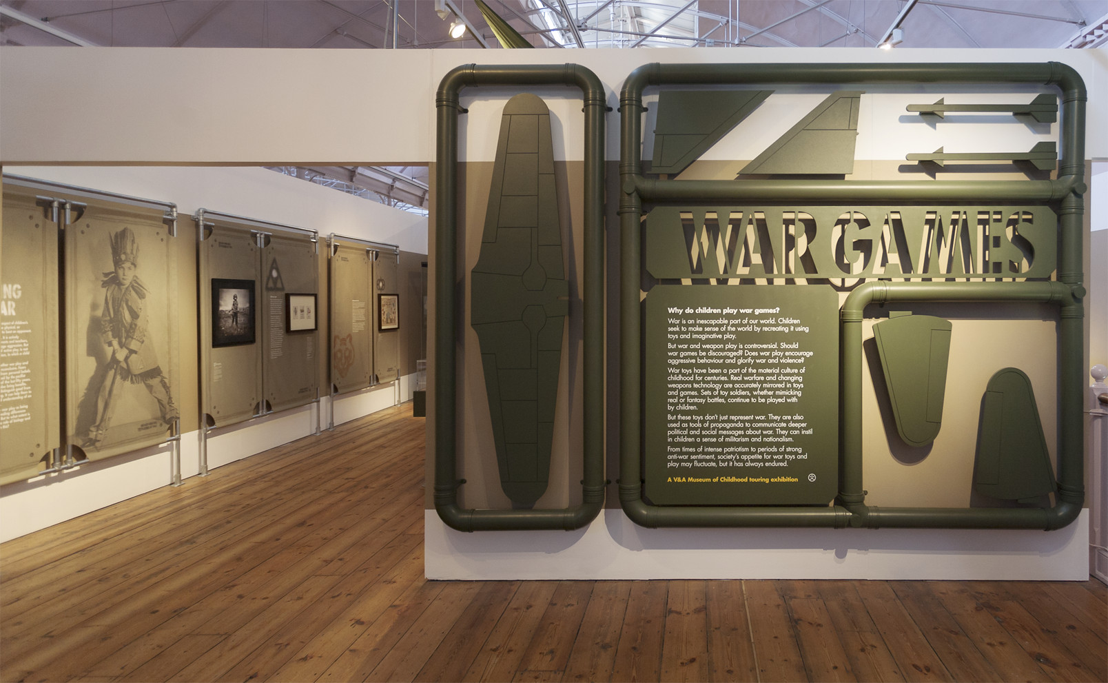 Like an oversized Airfix model kit, objects are mounted to their plastic sprues and flank the entrance marking the beginning of the exhibition.