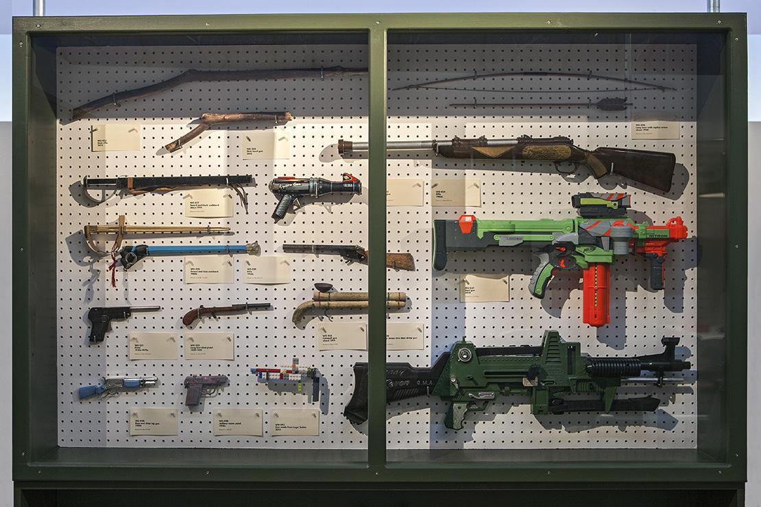 Toy gun cabinet.