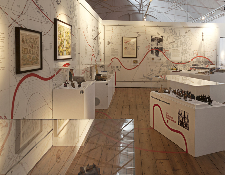 In this section strategic war maps lined the walls and plinths for models were formed with topographical  contours and placed around the gallery space.  An interactive bunker for children's play supported a watch tower from which the beam of a search tower patrolled the landscape.