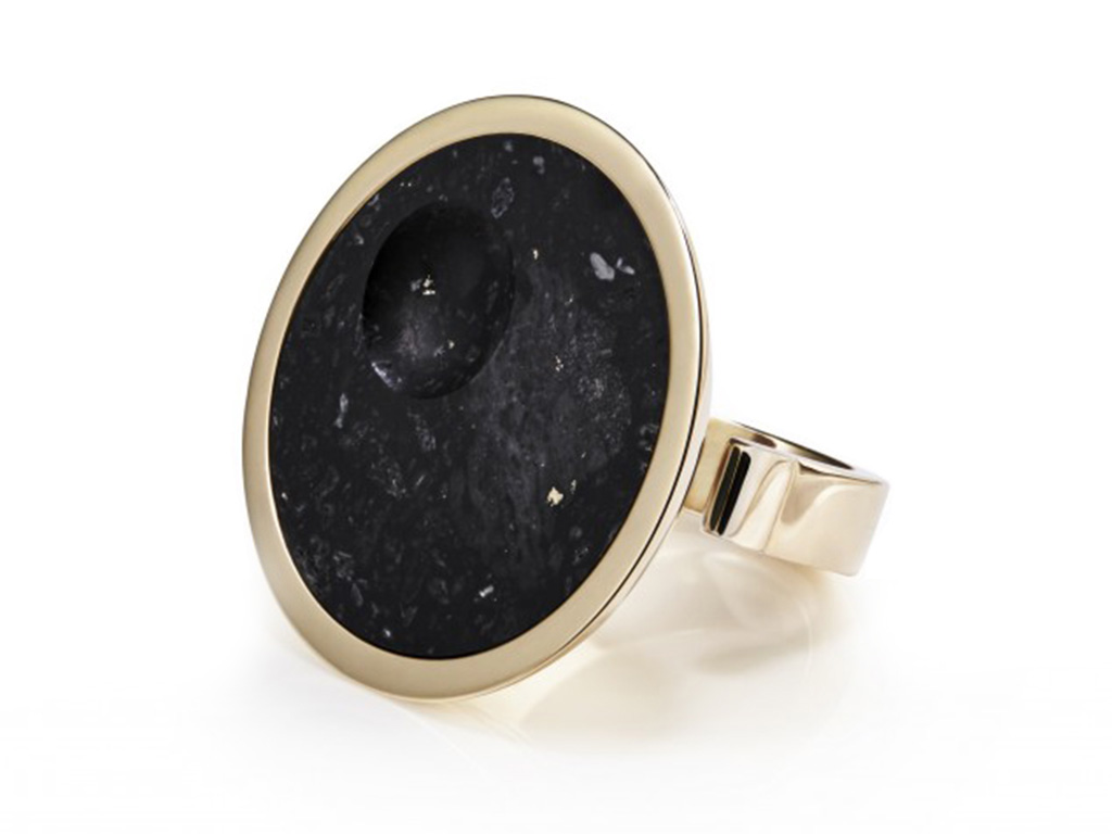 Gold malachite ring inset with meteorite.