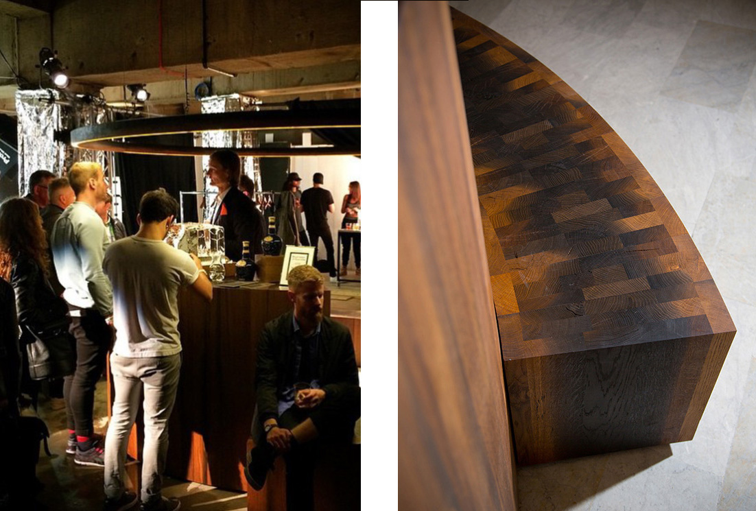 Left: The bar is christened at the launch party at Wallpaper* Handmade at Salone del Mobiles in Milan Right: Solid staves of 8000 year old oak have been tightly bonded together to form circular seating giving the ancient material a strangely pixellated surface pattern.