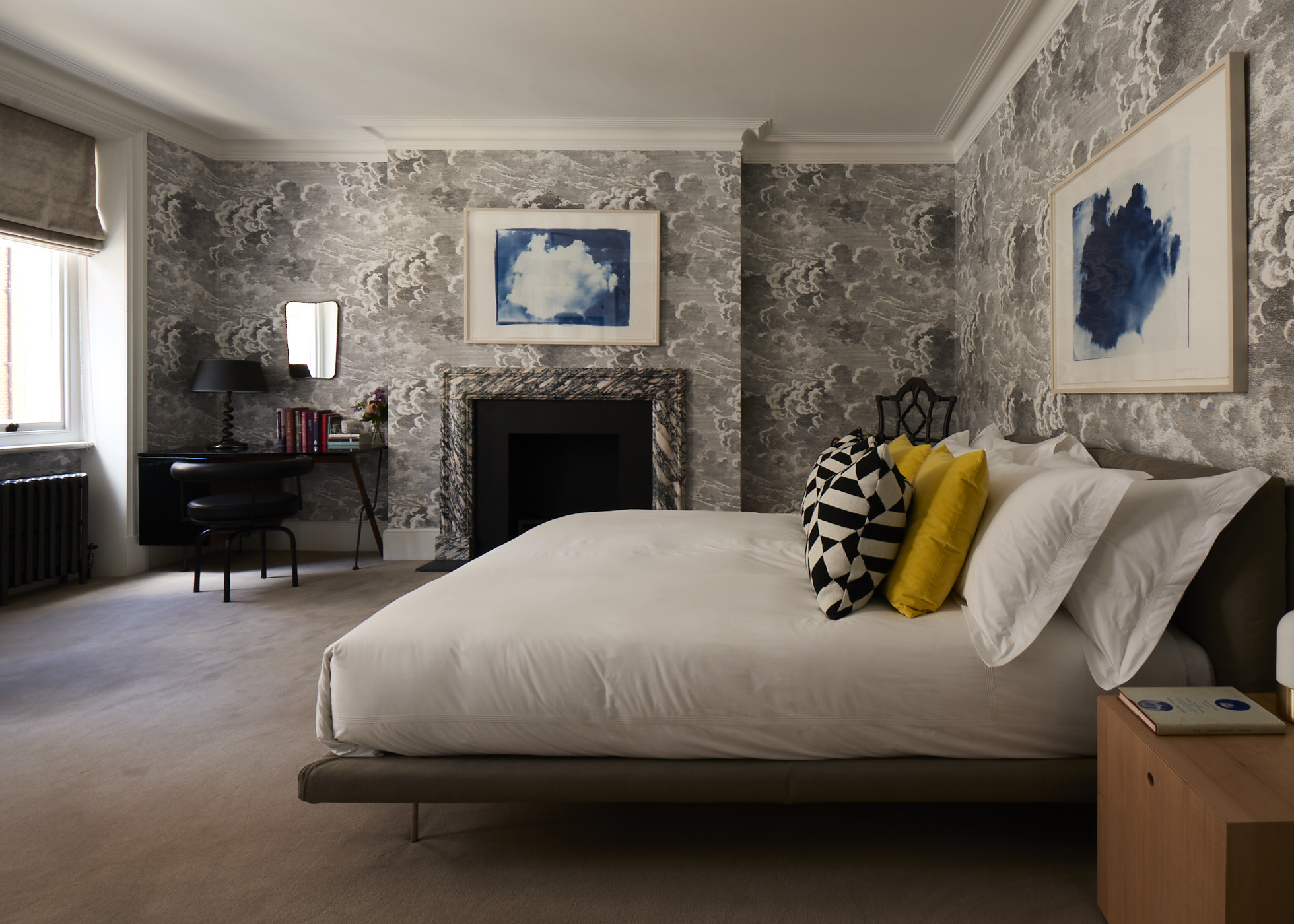 The guest bedroom with clouds wallpaper by Piero Fornasetti.