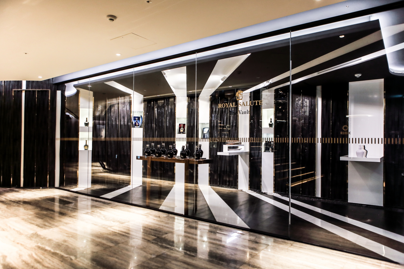 Dramatic monochromatic lines of white porcelain and black charred timber draw visitors into the tasting showroom.