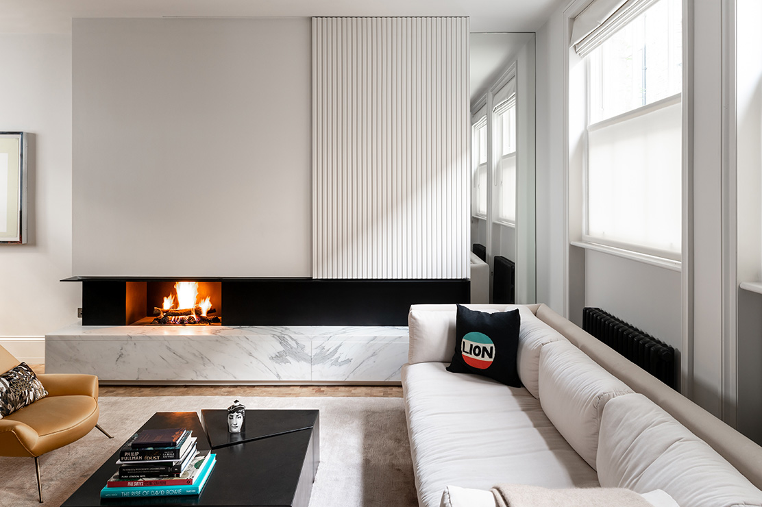 A sliding panel above the fire in the living room can be opened to reveal a library of vinyl records.