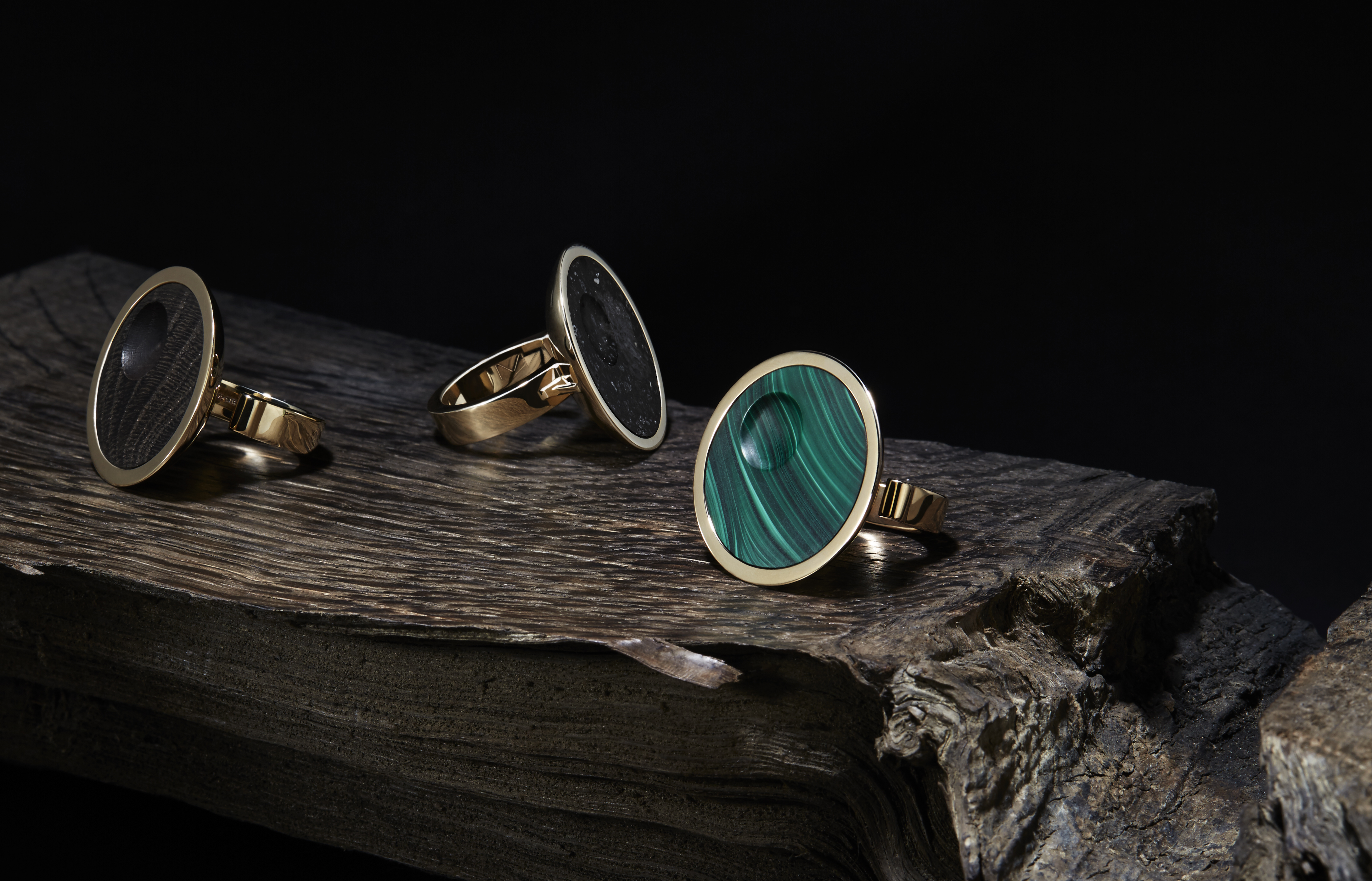 Collection of Oscar rings in solid gold, inset with malachite, eight thousand year old oak or meteorite.