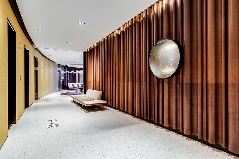Undulating leather panels in the lobby are interrupted by a metal lined aperture switching between moments of film projection and glimpses into the cellar beyond.