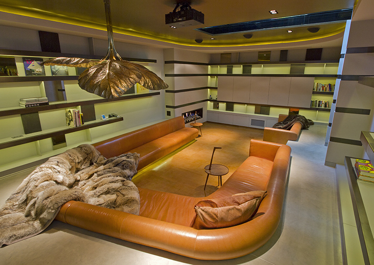 The basement houses a chestnut leather sunken conversation pit and adjacent bar for watching movies.