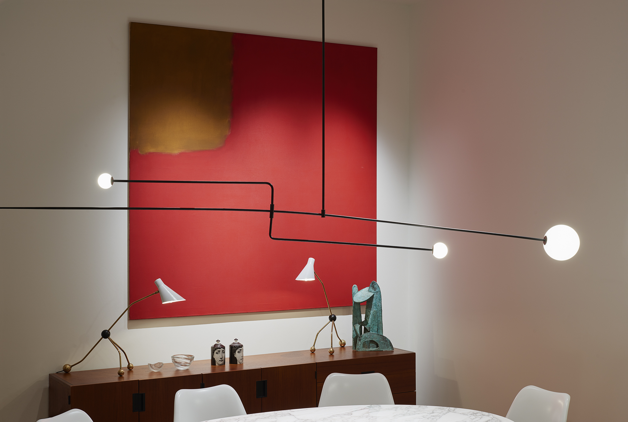 Vintage art and furniture as well as contemporary pieces were combined in the apartment interiors.