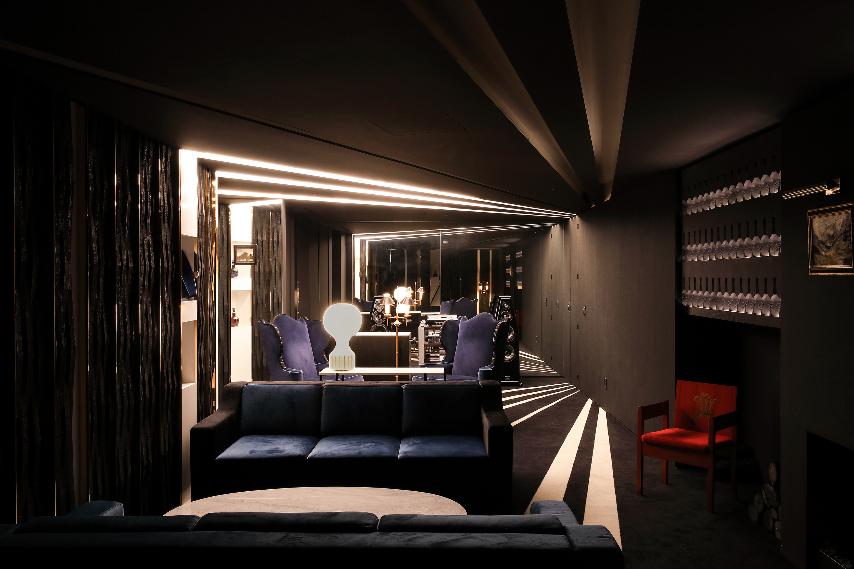 View of the VIP Salon with uplit shelves of whisky bottles cast into the walls.